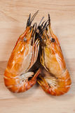 Two of shrimp grilled on wood plate Stock Photos