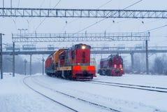 Shunting diesel locomotives during snowfall. Two shunting diesel locomotives on a branch line in winter during a snowfall stock photo