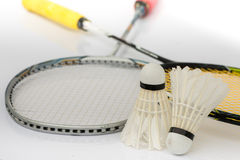 Two shuttlecocks and badminton racket Stock Images