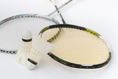 Two shuttlecocks and badminton racket Royalty Free Stock Photos