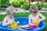 Two sibling boys having fun with water in summer Stock Photos