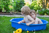 Two sibling boys having fun with water in summer Stock Photo