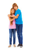 Two siblings boy and girl on white portrait Stock Photo