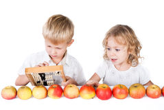 Two siblings counting apples  on whit Stock Image