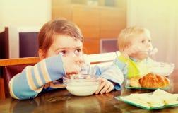 Two  siblings eating dairy breakfast Royalty Free Stock Image