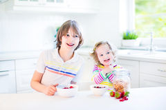 Two siblings having fruit for breakfast drinking juice Royalty Free Stock Photography