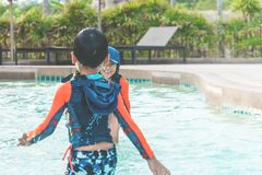 Two siblings in playing together in Water Aqua park pool royalty free stock photos