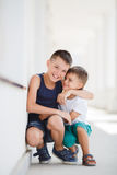 Two siblings spend their time on the street Royalty Free Stock Photography
