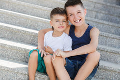 Two siblings spend their time on the street Royalty Free Stock Image