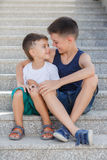 Two siblings spend their time on the street Stock Photos