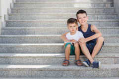 Two siblings spend their time on the street Stock Photography