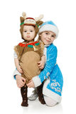 Two siblings in Xmas costumes Stock Photo