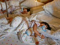 Two sick Asian baby girls, siblings, were together admitted and staying in a hospital stock photo