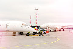 Two side profile parked airplanes with windows of wide-body airplane. Two side profile parked airplanes with windows of wide-body airplane, color graded with stock photos