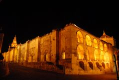 Two sides of the ancient palace illuminated near the Guadalquivir Royalty Free Stock Photos