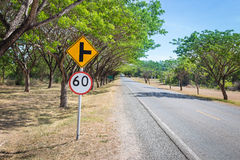The two sides of the country road with trees Royalty Free Stock Photo