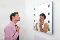 Two sides of getting ready in the morning Stock Photography