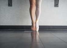 Two sides to a ballerina`s feet, both in and out of her dancing ballet shoes stock photography
