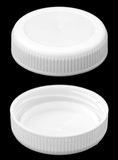 Isolated White Plastic Bottle Caps Royalty Free Stock Photography