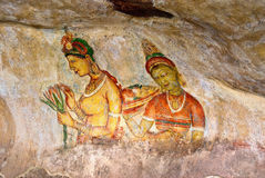 Two Sigiriya maiden with flowers: one of the 5th c Royalty Free Stock Photos