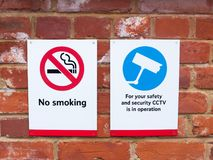 two signs at train station cctv no smoking Stock Photos