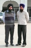 Two sikhs look somewhere in Delhi, India Stock Photo