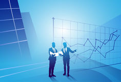 Two Silhouette Businessman Talking Discussing Document Report Over Finance Graph, Business Man Meeting Concept Royalty Free Stock Image