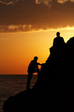 Two silhouette of people in beautiful sunset Stock Photography