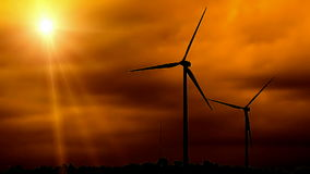 Two Silhouetted Wind Turbines stock video