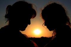 Two silhouettes stock photo