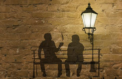 Two silhouettes on a bench stock illustration