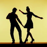 Two silhouettes on the dance-floor Royalty Free Stock Photo