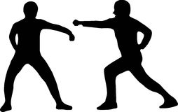 Two silhouettes fighting Royalty Free Stock Photography