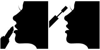 Two  silhouettes of girl creating make up Royalty Free Stock Photos