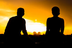 Two Silhouettes At Sunset Royalty Free Stock Photo