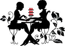 Two silhouettes of woman in manicure process Stock Images