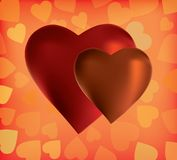 Two silk hearts on the orange background Royalty Free Stock Image