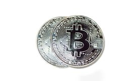 Two bitcoins over white background  Stock Images