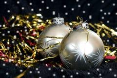 Two silver Christmas balls on black velvet Royalty Free Stock Photography