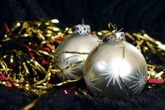 Two silver Christmas balls on black velvet Royalty Free Stock Photo