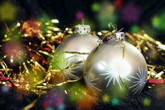 Two silver Christmas balls on black velvet Stock Photos