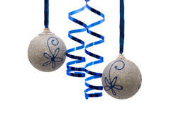 Two silver christmas balls with curly ribbon Stock Photos