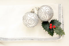 Two silver  Christmas balls on white background Royalty Free Stock Photography