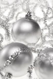 Two silver Christmas baubles Stock Photography