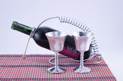 Two silver cups and a bottle of wine Stock Image