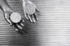 Two silver euro coins in futuristic robot hands Royalty Free Stock Photo