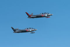 Two silver Fouga Magister jets flying at the Kaivopuisto Air Show Stock Images