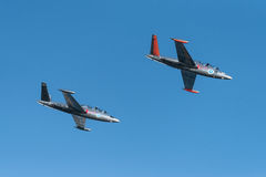 Two silver Fouga Magister jets flying at the Kaivopuisto Air Show Royalty Free Stock Image