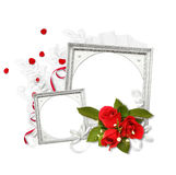 Two silver frames with red roses Stock Photo