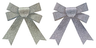 Two silver glitter decorative bows Royalty Free Stock Photos